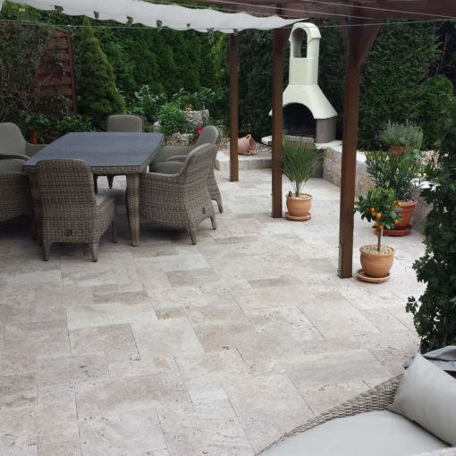 French pattern travertine paving in a outdoor alfresco