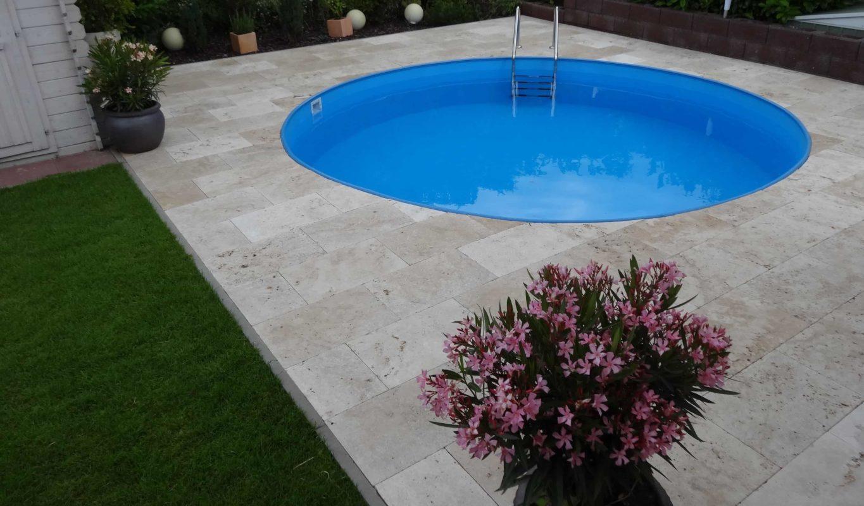 Ivory Travertine running in brick bond around a circle pool