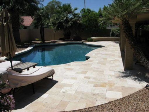 French pattern paving around a curved inground pool