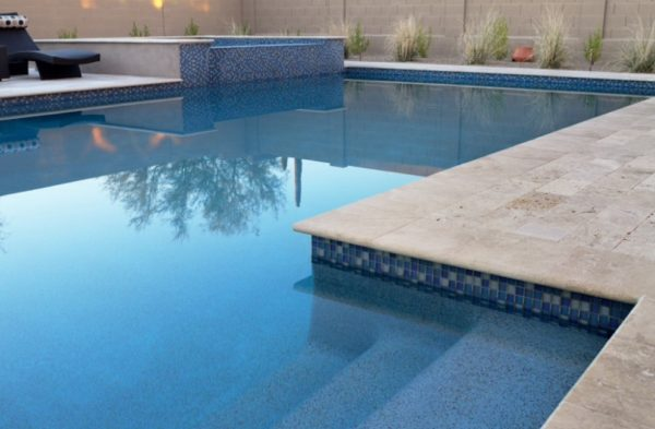 Bullnose pool coping in creme with mid blue pool