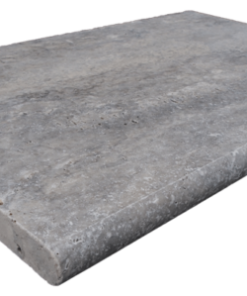 Bullnosed grey pool coping tile with rounded edge on one long side