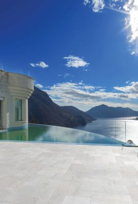 Infinity pool with french pattern limestone tiles
