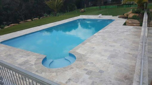 Silver travertine paving in a french pattern with bullnosed coping