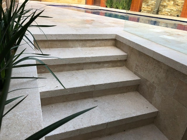 dropface travertine on steps
