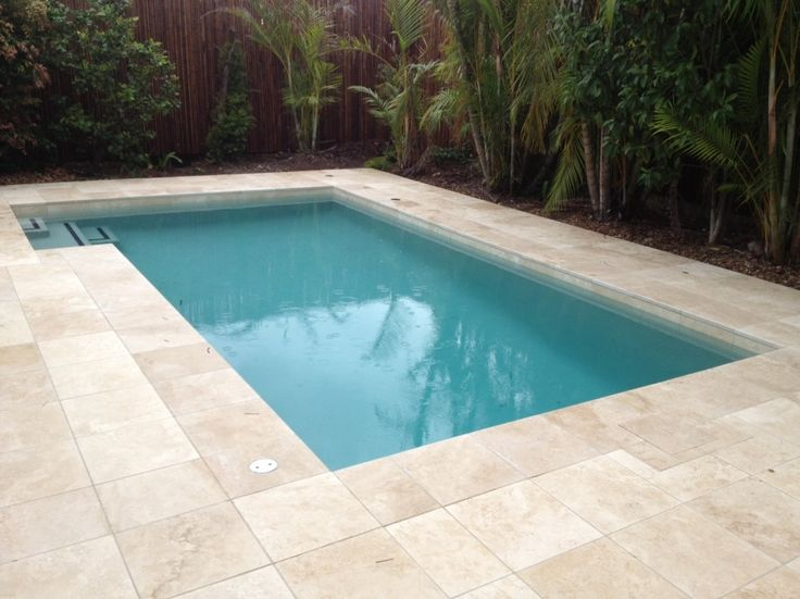 Wet tiles with a tumbled edge and stepout pool