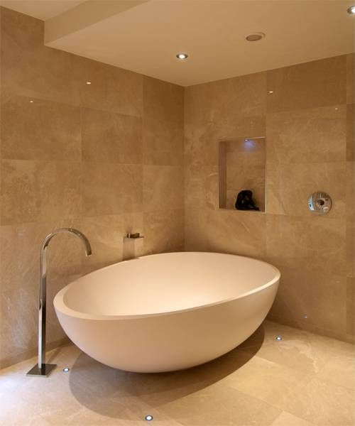 Creme bathroom tiles in natural stone