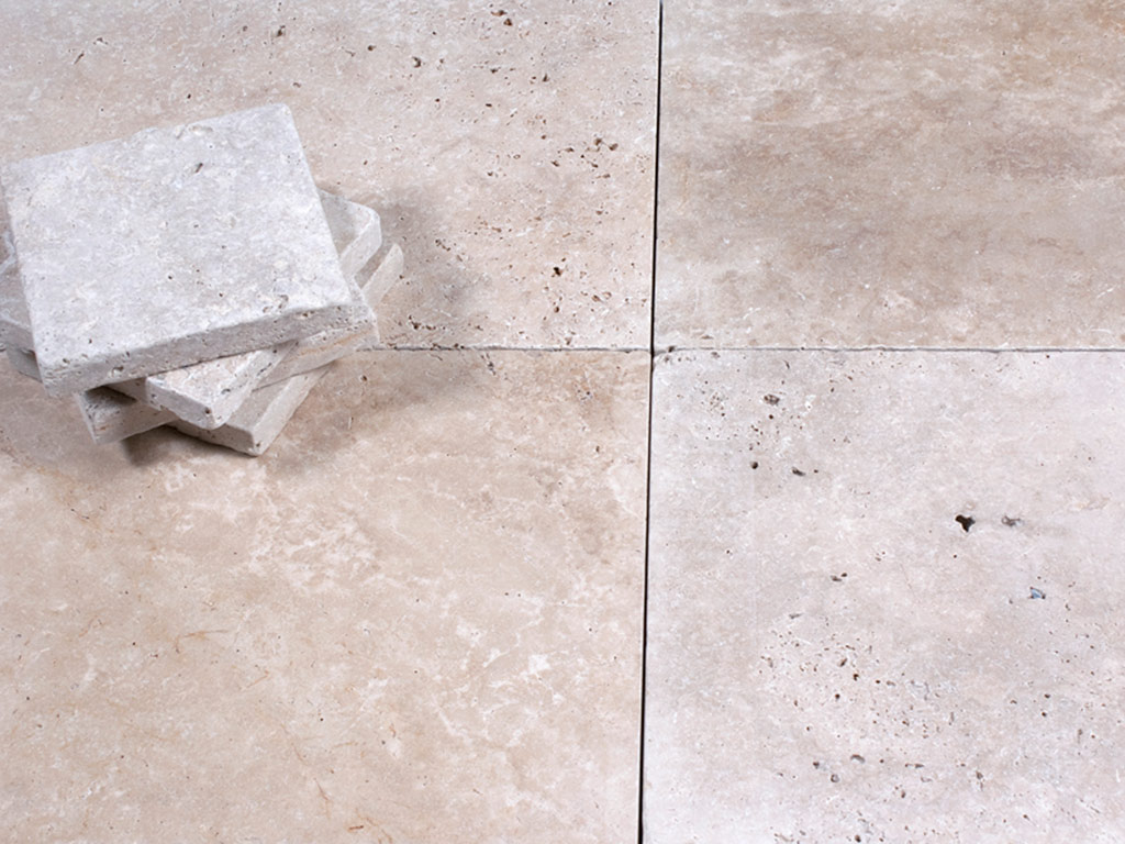 Cream travertine tiles in square size