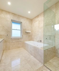 Creme bathroom tiles laid floor to wall