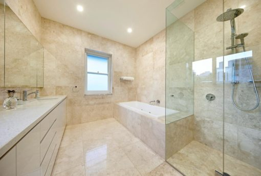 Creme bathroom tiles laid floor to wall