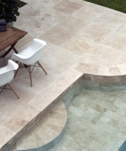 Square tiles around pool with curved corner