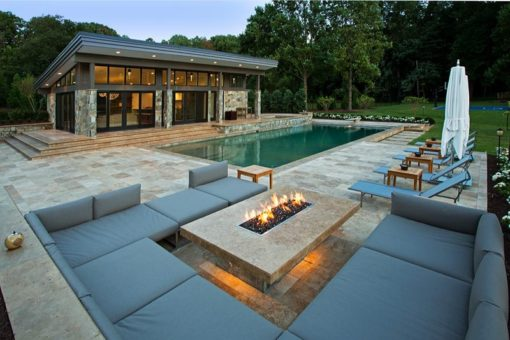 Brown travertine paving with built in external furniture