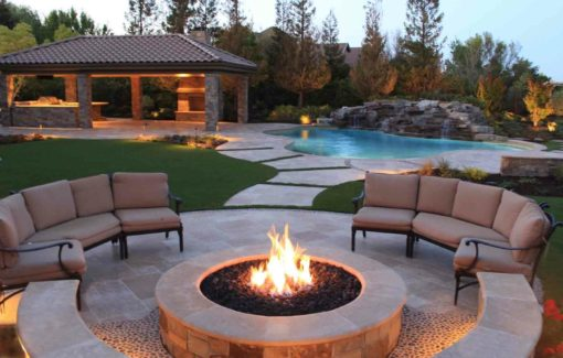 Brown travertine tiles in french pattern style around firepit