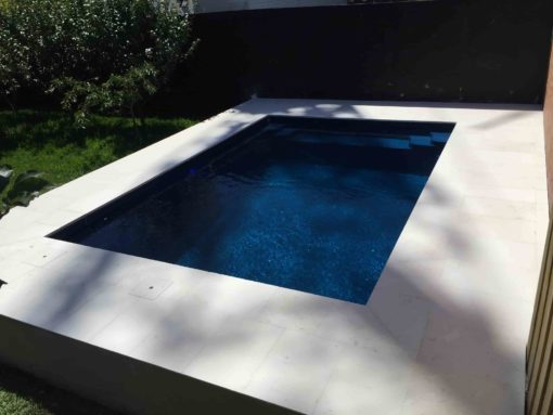 Limestone edge tiles on an aboveground pool