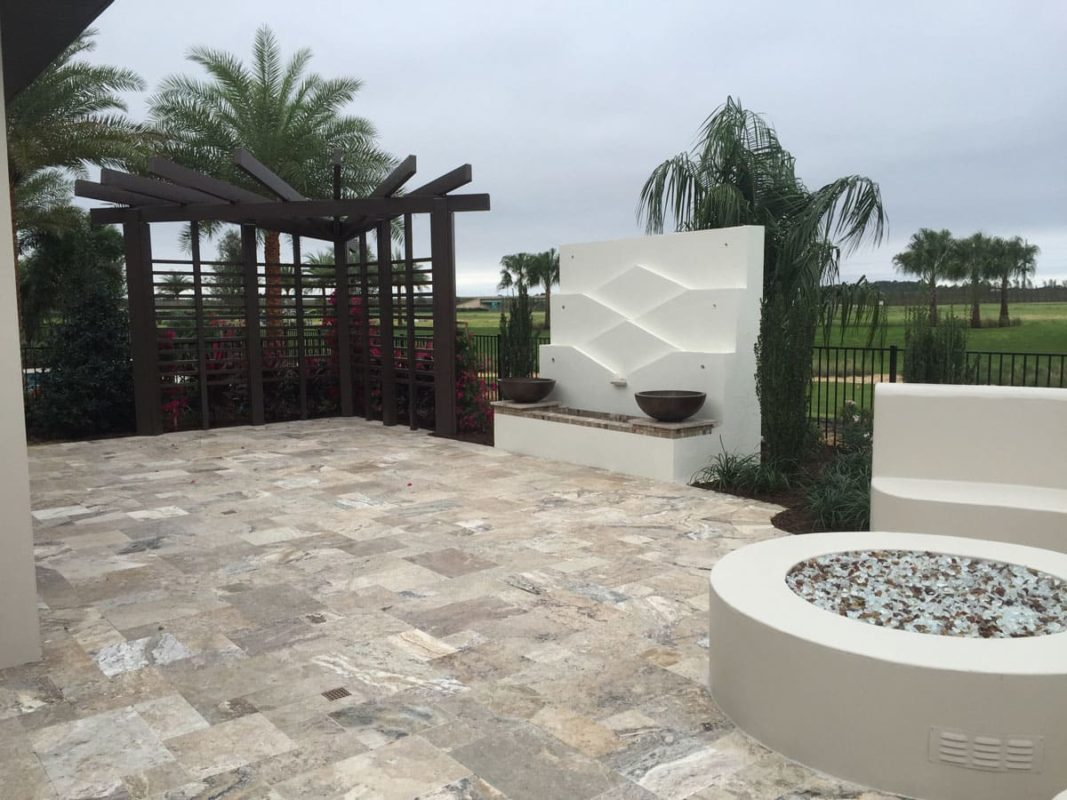 Beige and Grey Travertine tiles in backyard