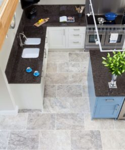 Brick bond internal paving in grey travertine tiles