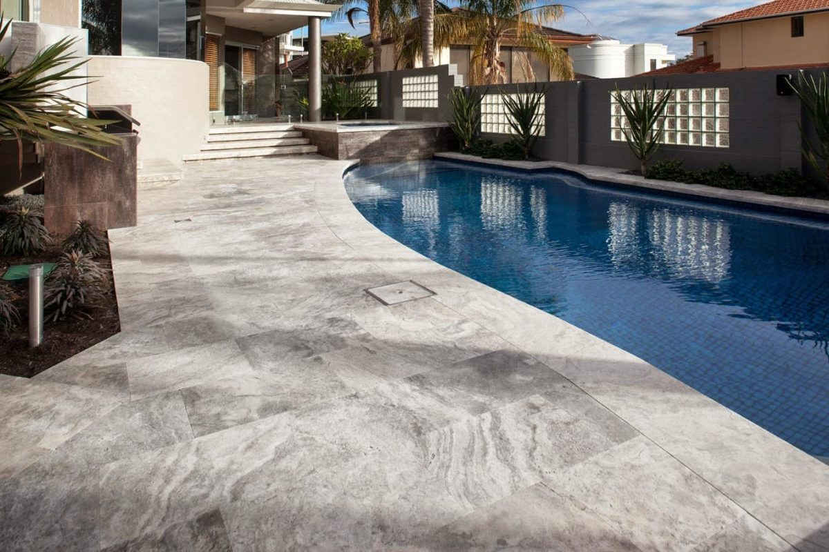 Curved silver travertine bullnose coping
