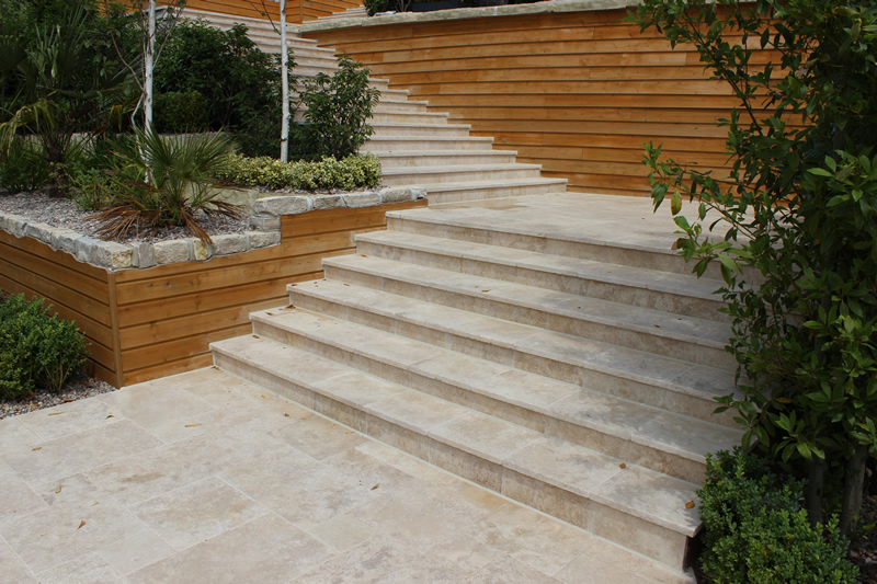 Tumbled edge ivory travertine step treads overhung 30mm