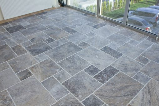 Light grey grout with silver french pattern travertine